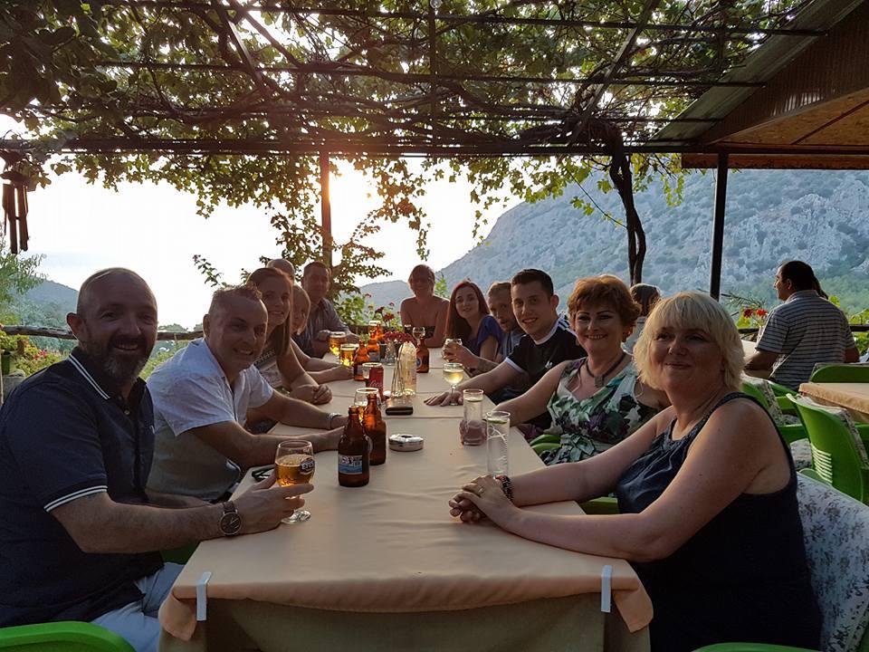 friends enjoying sunset restaurant