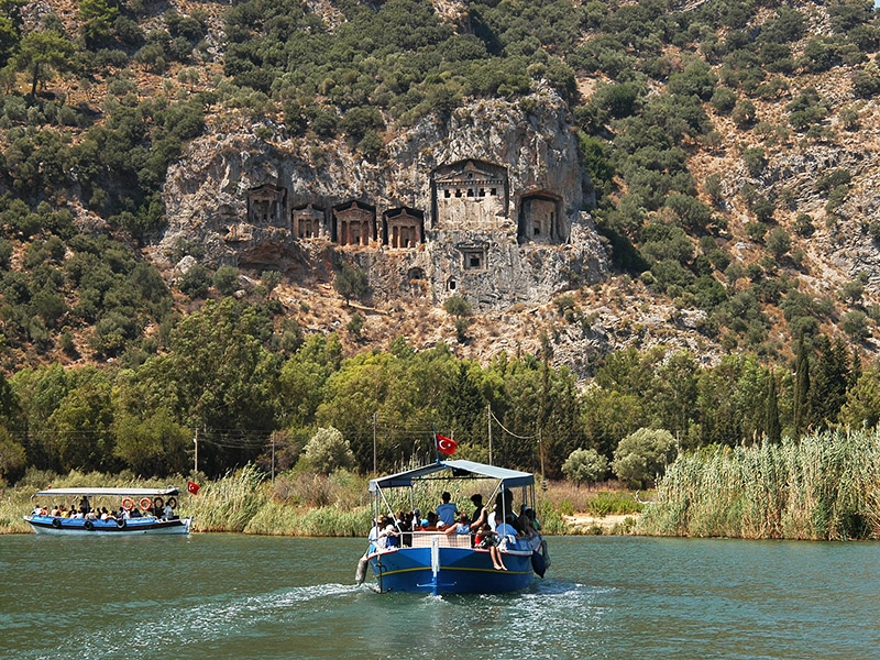 the view of rock tombs from the boats